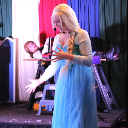 Magician has turned evil and is about to saw Anna, Elsa does not approve
