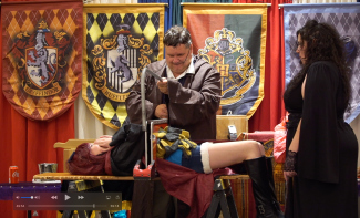 Under the imperious curse, Bella makes the headmaster cut Illy in two